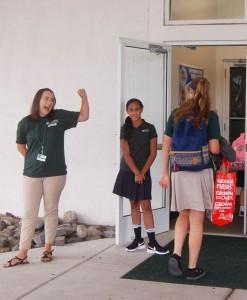 DSC 0003B - teacher, students welcome at door