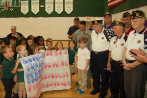 DSC 0055A - Atlantic Christian kindergarten students present flag banner to veterans