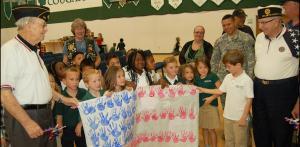 DSC 0057B - KA class presents paper flag to veterans, narrow crop