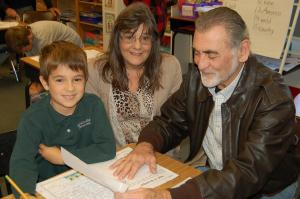 DSC 0214A - gradnparents with grandson at desk